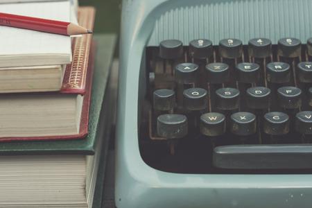 typewriter and book close up Standard-Bild