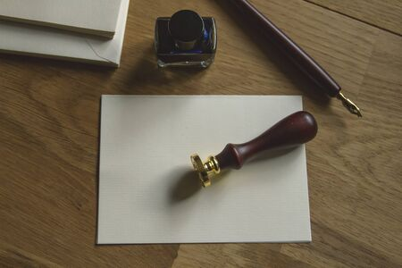 Blank paper, fountain pen, seal and ink on the wooden desk