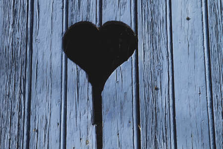 Blue wooden wall with heart