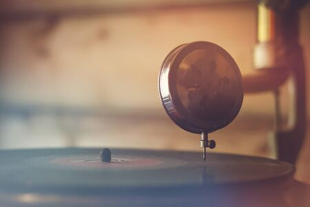 Playing an old vinyl album in a vintage turntable