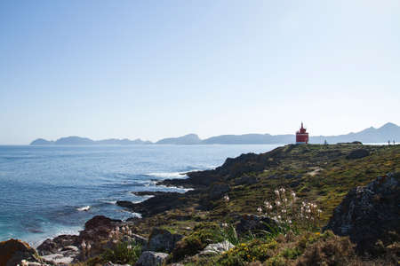 Red lighthouse in Punta Robaleira, Galicia, Spain