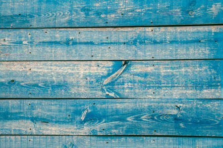 Old rustic wooden wall with peeling paint