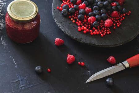 Homemade jam and fresh berries