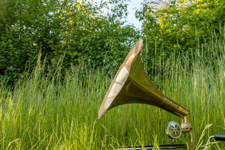 Vintage phonograph on the green garden grass