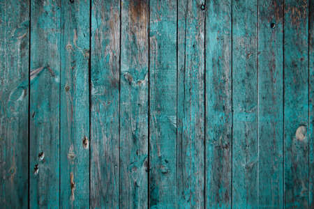 Old blue painted distresed wooden planks wall