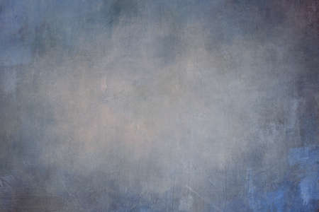 Splattered blue grungy colored canvas background or texture