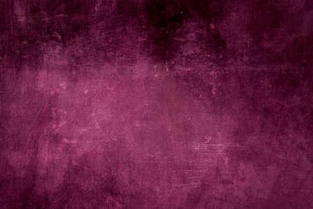 Grungy dark pink background or texture with dark vignette borders