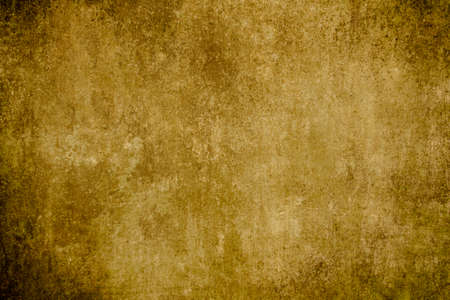 Golden colored old wall grungy background or texture