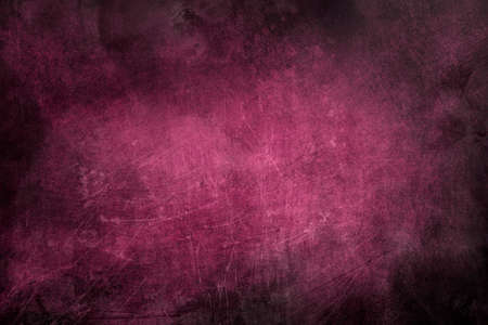 Dark pink metalic scraped wall texture or background with dark vignette borders