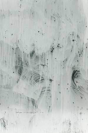 White paint on a store window, abstract background