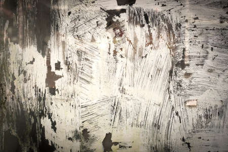 White paint on a shop window, abstract background