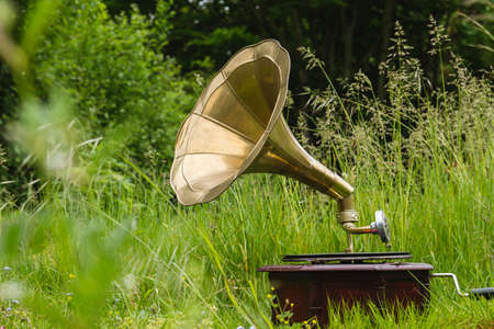 Old vintage gramophone playing music in the garden
