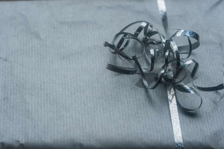 Christmas present with silver wrap paper and ribbon
