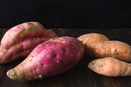 Red colored organic raw sweet potatoes