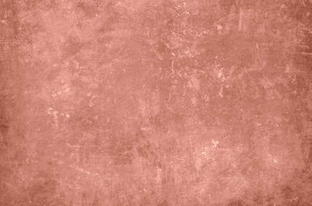 Old red scraped wall grungy background or texture