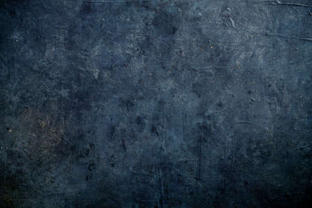 Dark blue grungy backdrop with texture and golden splatters 免版税图像