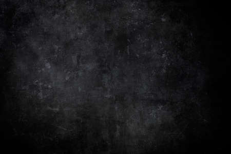 Old scraped black wall grrungy background or texure