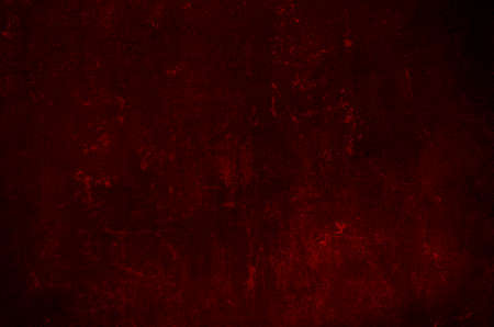 Dark red scraped wall grungy background or texture
