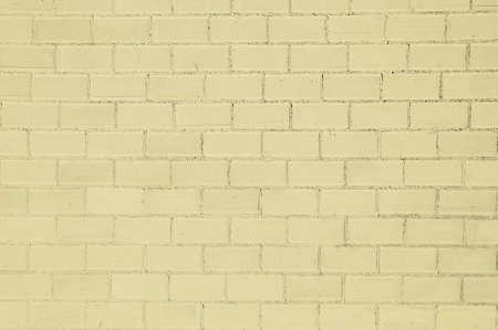 Yellow painted bricks wall background Foto de archivo