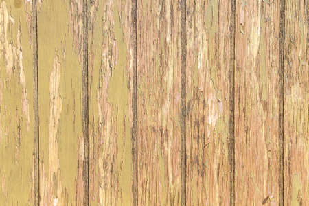 Old rustic wooden planks wall with peeled paint