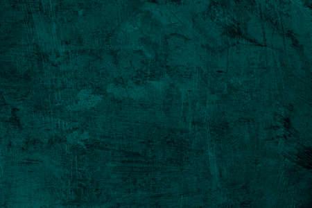 Dark green grungy background or texture