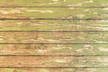 Old rustic wooden planks wall with peeled paint Reklamní fotografie