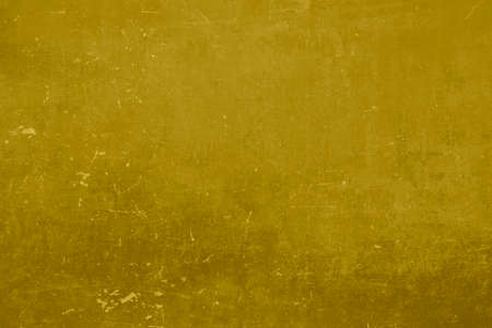 Ochre scratched metallic wall abstract background or texture