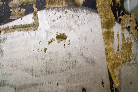 Detail of old silver graffiti on corroded metal sheet, abstract background grunge texture