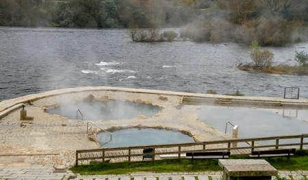 Hot springs Muiño da Veiga, pools in Minho riverbed in Ourense, Spain