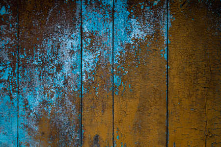 Old rustic wooden planks wall with blue and brown peeling paint, grunge texture or background Stock fotó