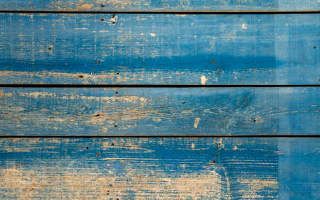 Old blue painted wooden planks wall background or texture