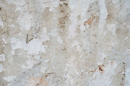 Old whitewashed lime plaster wall, grunge background or texture