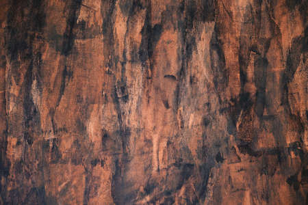 Brown and black grungy painted stucco wall background Standard-Bild
