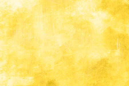 Yellow painted grunge backdrop background or texture