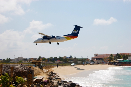 Airplane Landing over Beach