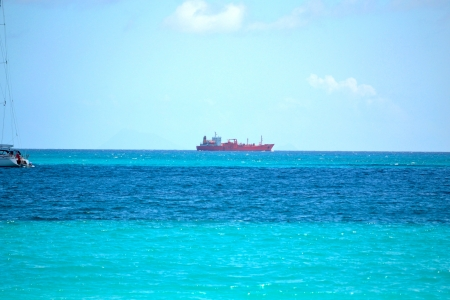 caribbean cruise: Large Oil Shipping Tanker on the Horizon in the Caribbean Stock Photo