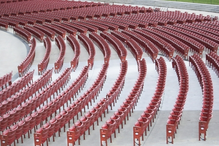 Many Rows of Red Outdoor Amphitheater Seats Stock Photo