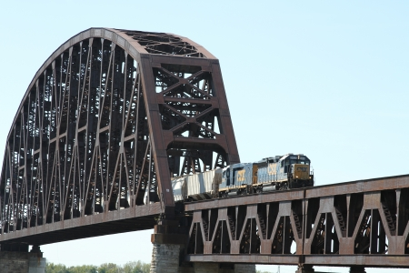 freight train: Train Crossing a Steel River Bridge