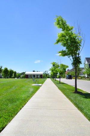 cape cod style: Sidewalk in a Brand New Suburban Neighborhood Development Stock Photo