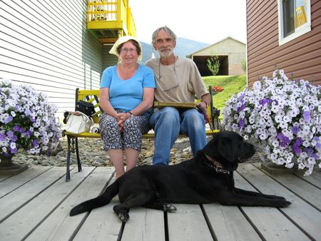 Couple on hot day with dog photo