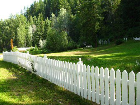 painted wood: White picket fence Stock Photo