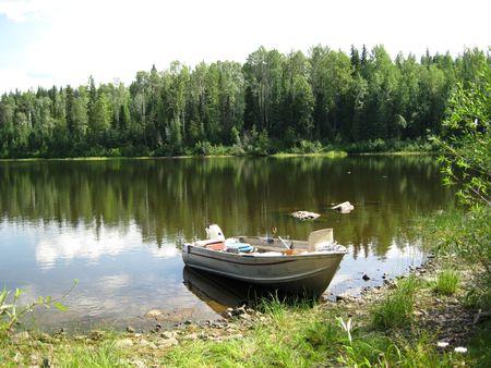 Aluminum boat on shore