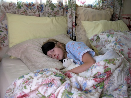 Girl sleeping comfortable photo