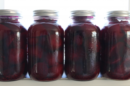 Pickles of Beets on a shelf photo