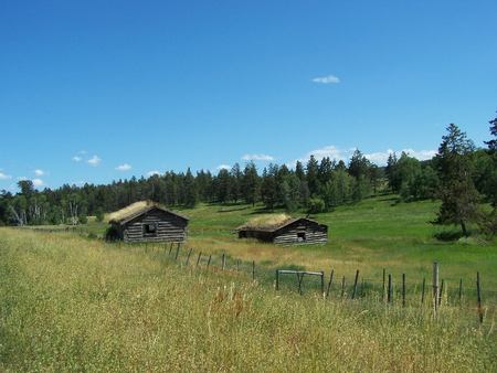 run down: OLd sod roofed cabins scenic Stock Photo