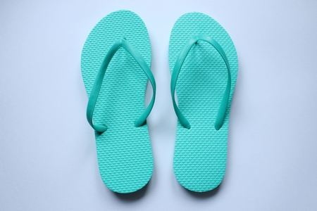 Pairs of beach shoes tong in colors on white background