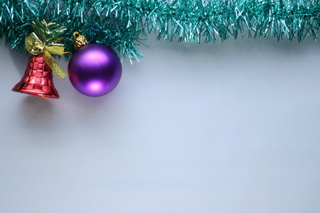 Christmas decorations on a piece of bright green garland on a white background 스톡 콘텐츠