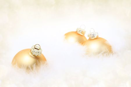 Golden baubles in white feather