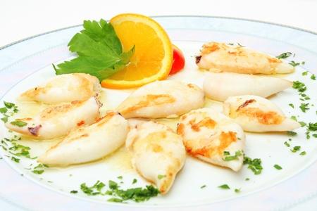 decapod: Calamari on plate in restaurant