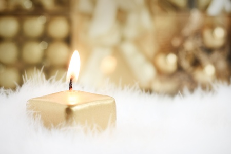 Golden candle, selective focus on flame Stock Photo